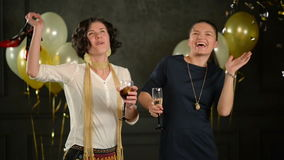 Laughing Women are Enjoying Disco Party Dancing and Drinking Alcohol. Two Brunettes Dance Together Holding Glasses with stock footage