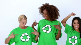 Laughing women with green ecologic tshirt. Showing recycle sign stock footage