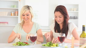 Laughing women having dinner together Royalty Free Stock Photo