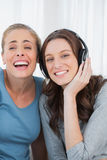 Laughing women listening to music Stock Photography