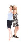 Laughing women pointing at the camera Stock Image