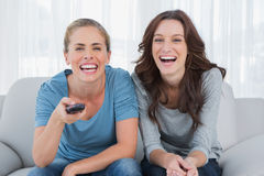 Laughing women watching television Royalty Free Stock Photo
