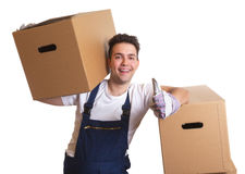 Laughing worker with a box on his shoulder showing thumb up Royalty Free Stock Images