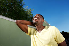 Laughing young african man walking outside Stock Image