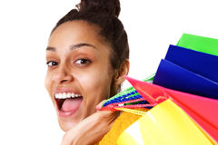 Laughing young african woman with shopping bags Stock Images