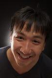 Laughing young asian man look at the camera Royalty Free Stock Photo