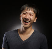 Laughing young asian man portrait Royalty Free Stock Image