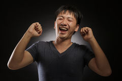 Laughing young asian man portrait Royalty Free Stock Images