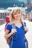 Laughing young backpacker in Europe Royalty Free Stock Image