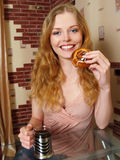 Laughing young beautiful woman with cup of coffee Royalty Free Stock Images