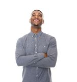 Laughing young black man with arms crossed Stock Photography