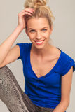 Laughing young blonde woman sitting Stock Photo