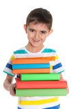 Laughing young boy with books Royalty Free Stock Photo