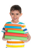 Laughing young boy with books Stock Photo