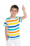 Laughing young boy holds his thumb up Stock Images