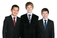 Laughing young boys in black suits Stock Photo
