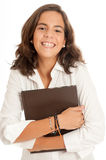 Laughing young brunette  holding a book Royalty Free Stock Images