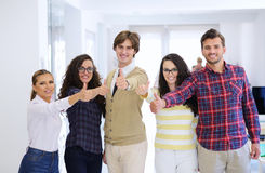 Laughing young business entrepreneurs in trendy clothing celebrating a success Royalty Free Stock Photo