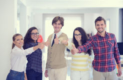 Laughing young business entrepreneurs in trendy clothing celebrating a success Royalty Free Stock Image