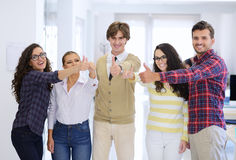 Laughing young business entrepreneurs in trendy clothing celebrating a success Royalty Free Stock Photos