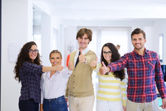 Laughing young business entrepreneurs in trendy clothing celebrating a success Stock Photography