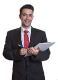 Laughing young businessman with clipboard Stock Photos