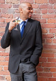 Laughing young businessman with a glass of wine royalty free stock images