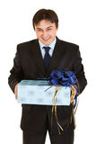 Laughing young businessman holding gift in hands Royalty Free Stock Photography