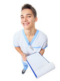 Laughing young doctor with clipboard Royalty Free Stock Image