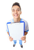 Laughing young doctor showing empty clipboard Stock Images
