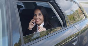 Laughing young executive on phone in car stock video