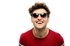 Laughing young fashion man with sunglasse Royalty Free Stock Photo