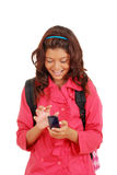 Laughing young girl with cell phone Stock Photos