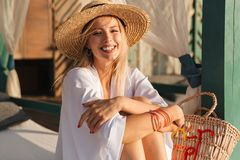 Laughing young girl in summer hat and swimwear. Resting at the beach Royalty Free Stock Photos