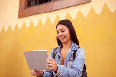 Laughing young girl with a tablet pc Royalty Free Stock Photos