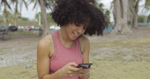 Laughing young girl taking selfie in park stock footage