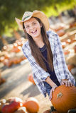 Laughing Young Girl with a Wheelbarrow at the Pumpkin Patch Stock Images