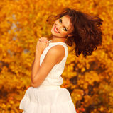 Laughing young girl in a white dress Stock Images
