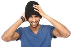 Laughing young man with black hat Stock Photography