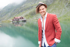 Laughing young man standing near a lake Royalty Free Stock Photography