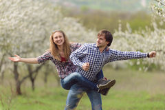 Laughing Young Man and Woman Stock Image