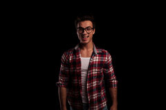 Laughing young sexy man in checkered shirt and jeans Stock Image