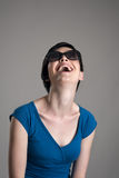 Laughing young short hair cutie wearing sunglasses Royalty Free Stock Photography