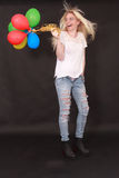Laughing young woman with aerial balloons in the hand Royalty Free Stock Photos