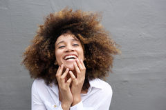 Laughing young woman with afro hair Stock Photo