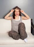 Laughing young woman with book Stock Photography