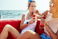Laughing young woman canoeing with friends in the summer stock photos