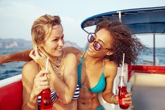 Laughing young woman canoeing with friends in the summer royalty free stock photo