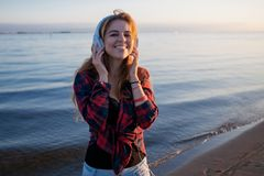 Laughing young woman enjoying the music. Royalty Free Stock Photography
