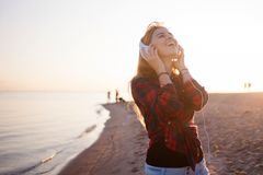 Laughing young woman enjoying the music. Royalty Free Stock Photos